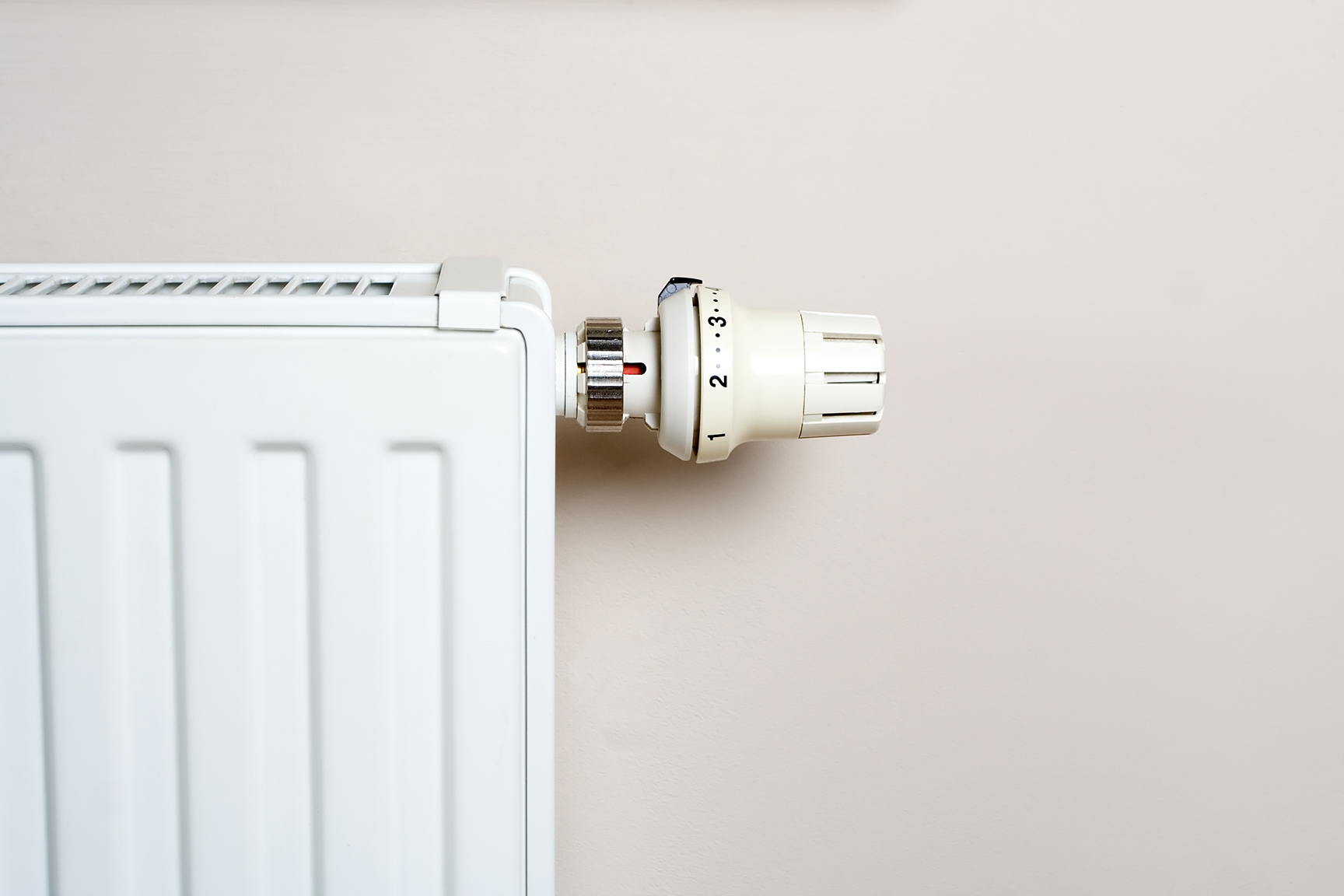 Radiator with knob on wall